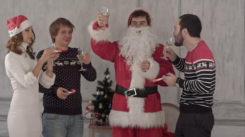 Friends celebrate new year and christmas. They clink glasses and drink champagne Footage