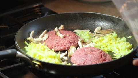 Cooking hamburger meat ground beef in hot frying pan on stovetop Footage