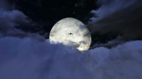 Airplane flying over the clouds in full moon footage Footage