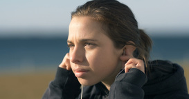 Girl Putting In Headphones To Her Ears Model Woman Portrait stock footage