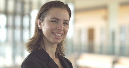 Young casual business woman smiling portrait close up office backround Footage