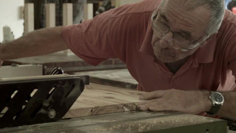 Retirement Age Man Working Indoors In Hobby Shed Or Workshop With Carpentry Powe stock footage
