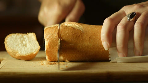Fresh Golden Brown Bread Food Prep Cutting Up In Kitchen stock footage
